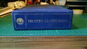 The spine, now with the original decorated covering reapplied.
